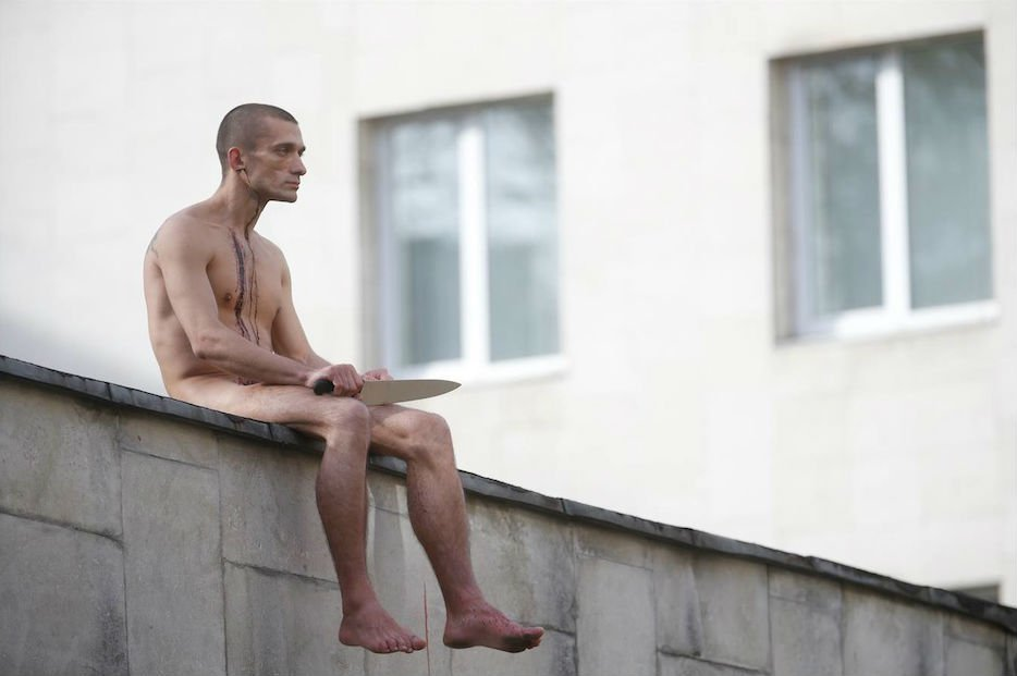 Performance artist Pyotr Pavlensky cuts off earlobe in latest act of protest