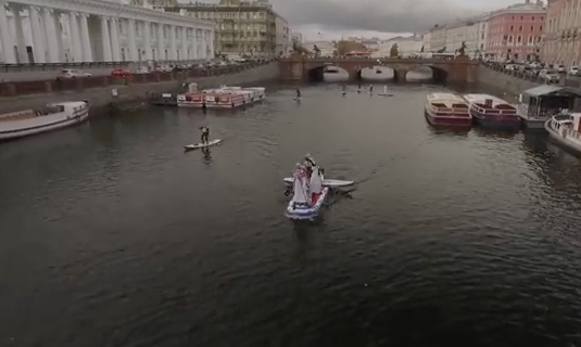 Go paddle boarding on a St Petersburg canal