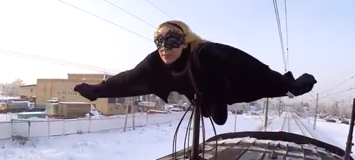 Meet Kobzarro, the Russian Batgirl who surfs on trains