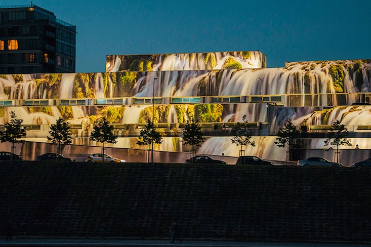 Former Soviet garage becomes a huge waterfall in Vilnius