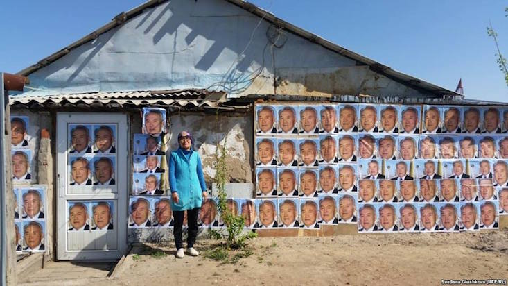 Meet the Kazakh woman using presidential portraits to avoid eviction