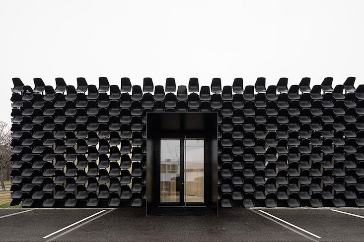 Czech architects create facade from 900 plastic chairs